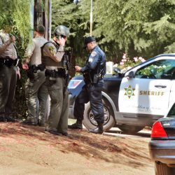 Los Angeles County Sheriff's deputies and California Highway Patrol officers gather in front of a home on Crown Valley Road after a report of an armed, barricaded suspect in Acton on Saturday, Sept. 19, 2020.  Dan Watson/The Signal