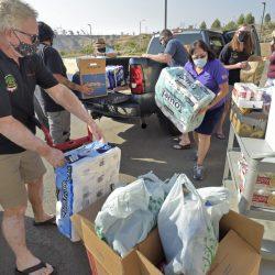 Members of the Santa Clarita Elks Lodge #2379 unload food, paper products and personal hygiene supplies to the Bella Via Senior Center in Santa Clarita on Thursday, September 24, 2020.  Dan Watson/The Signal