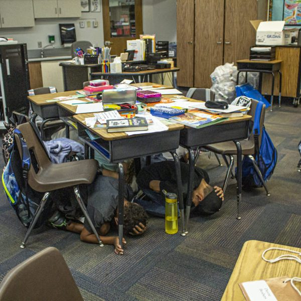 Second- and third-graders in Shellie Dungan's class at Skyblue Mesa Elementary School practice hiding under their desks during the