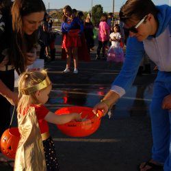 FILE PHOTO Wonder Woman Phoenix Silvers chooses which candy she wants after playing a carnival game at the Halloween Splash Carnival at the Castaic Sports Complex on Saturday. Raychel Stewart/The Signal