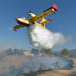 A Super Scooper makes a drop on a nine acre brushfire at the end of Dockweiler Derive in Newhall on Wednesday, November 6, 2019.  Dan Watson/The Signal