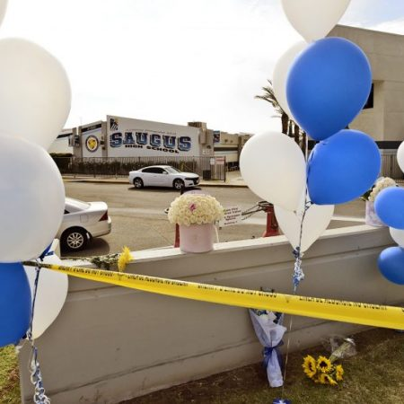 Balloons and flowers stand in front of Saugus High School which was still closed for investigation on Friday, November 15, 2019.  Dan Watson/The Signal