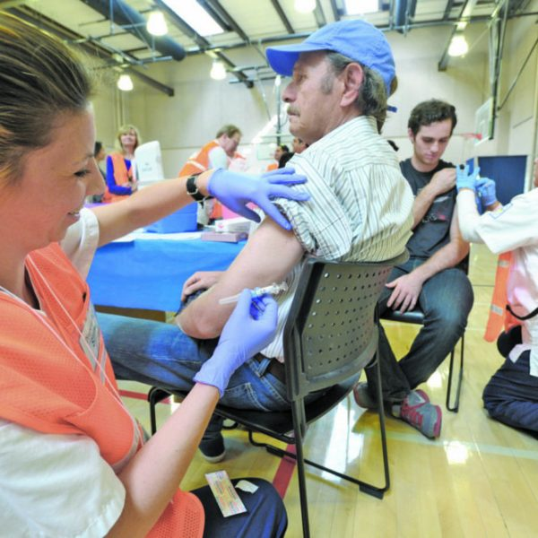 SIGNAL FILE PHOTO: College of the Canyons student nurse Lauren Deckman, left, prepares to give Hinnani Rabih of Valencia his flu shot as he joins the hundreds  people who attended the L.A County free flu shot event held at College of the Canyons in Valencia on Friday, November 15, 2019.