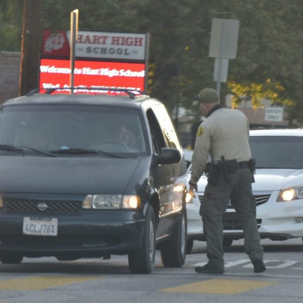 Deputies set up a containment in Newhall as they search for a felony vandalism suspect on Wednesday, Aug. 26, 2020. Dan Watson/ The Signal