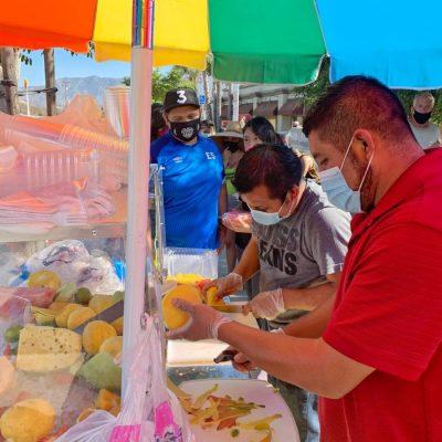 Leobardo Ramirez (front) and Sergio Medina chop and serve fruit for the business La Palma Fresh Fruit in Canyon Country on Monday, July 13, 2020. Tammy Murga/ The Signal