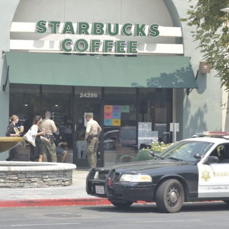 SCV Sheriff's Station deputies interview witnesses at a Starbucks in Valencia on Aug. 20, 2020. Dan Watson/ The Signal