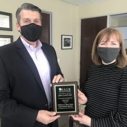 Hart district Superintendent Mike Kuhlman and Clinical Coordinator Stephanie Cotcher hold the NASW Award for State Organization of the Year. Courtesy photo.