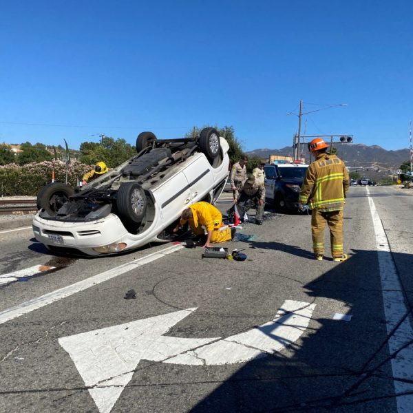 Los Angeles County Fire Department personnel respond to an overturned vehicle in Newhall on Sunday. Bobby Block/The Signal